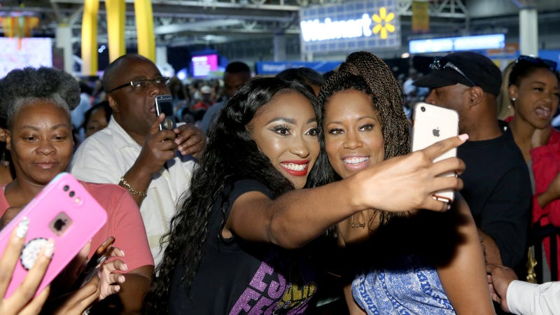 Regina King (R) takes a selfie with a fan at Essence Festival 2018 on July 6, 2018, in New Orleans.