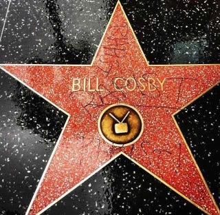 Illustration for article titled 'Rapist' Is Written All Over Bill Cosby's Walk of Fame Star