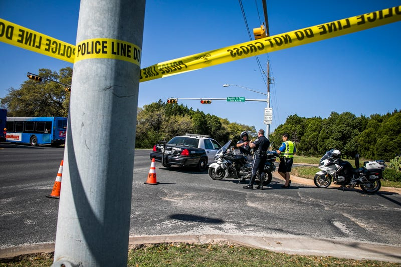 Police tape marks off the neighborhood where a package bomb went off March 19, 2018, in Austin, Texas, one of several in the Austin area in recent days.