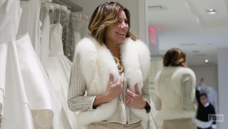 Luann trying on bridal furs. Screenshot via Bravo.