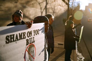 Protesters demonstrate outside Bill Cosby's comedy show Jan. 17, 2015, at the Buell Theater in Denver. Cosby has been facing allegations by numerous women who claim the comedian drugged and sexually assaulted them.Marc Piscotty/Getty Images