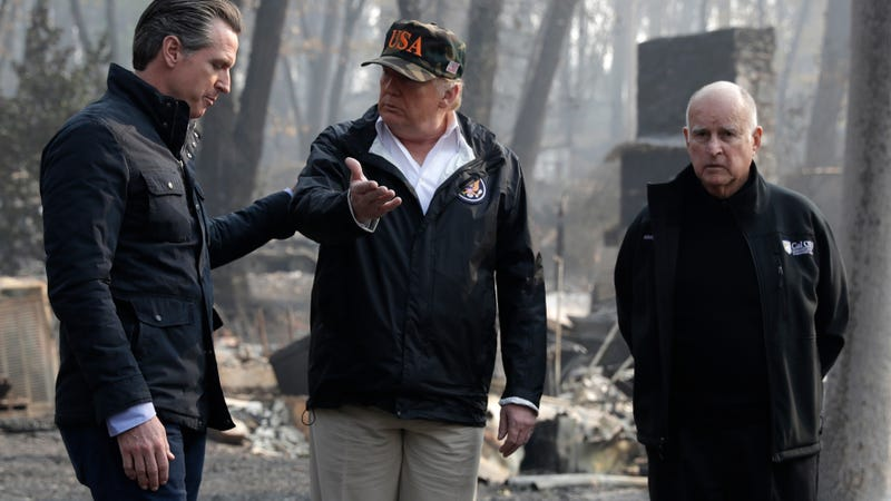 President Donald Trump talks with Gov.-elect Gavin Newsom, left, and as California Gov. Jerry Brown listens during a visit to a neighborhood impacted by the wildfires in California.