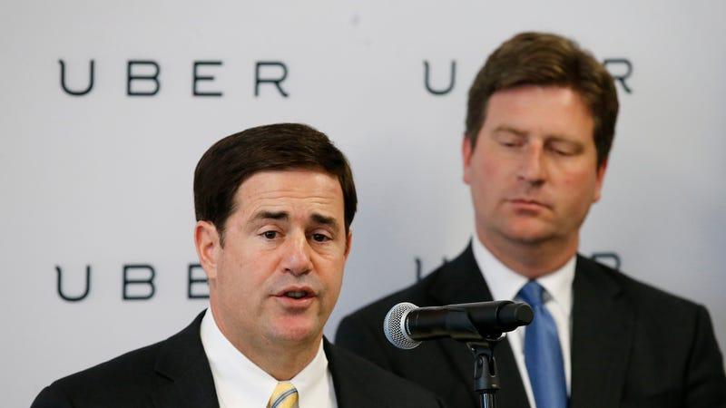Arizona Gov. Doug Ducey, on the left