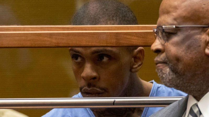 Eric Holder, charged with murder in the death of Nipsey Hussle, seen with his now-former defense attorney Christopher Darden