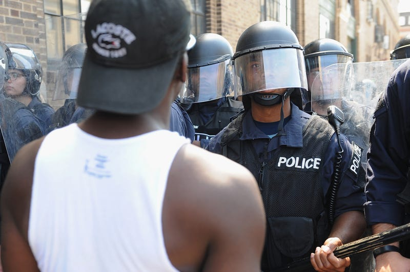 Police in riot gear stand by as protesters demonstrate following a not-guilty verdict in Police Officer Jason Stockley's trial over shooting death of motorist Anthony Lamar Smith on Sept. 15, 2017, in St. Louis. (Michael B. Thomas/Getty Images)