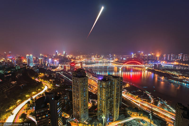 Illustration for article titled Beautiful long exposure photo of the lunar eclipse rising over China