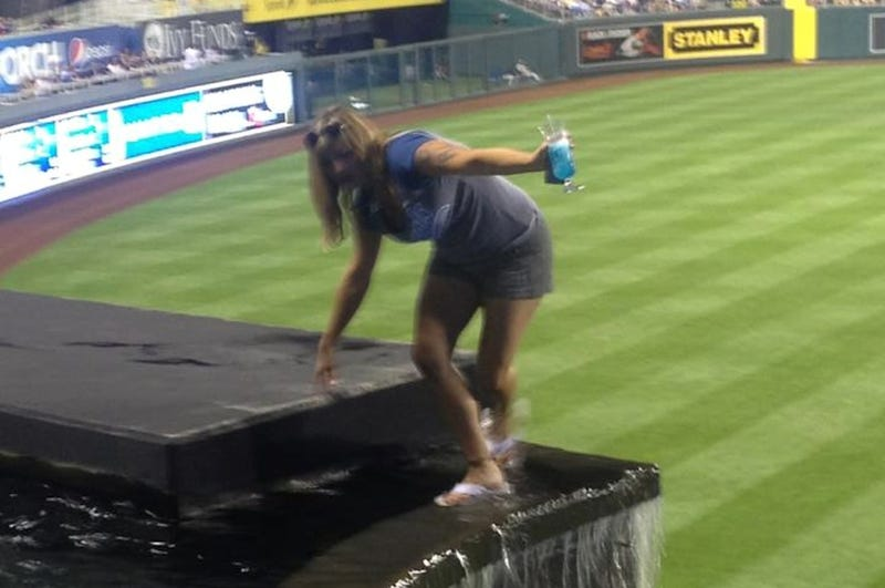 Illustration for article titled Lady Goes For A Stroll Through The Kauffman Stadium Fountain