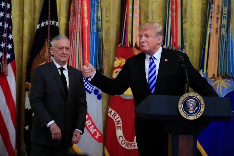 President Donald Trump with Defense Secretary Jim Mattis gestures during a reception commemorating the 35th anniversary of the attack on Beirut Barracks in the East Room at the White House in Washington, Thursday, Oct. 25, 2018.