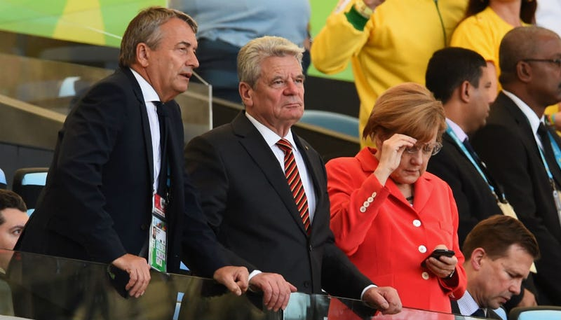 Illustration for article titled This Photo of Angela Merkel at the World Cup Final Needs a Caption