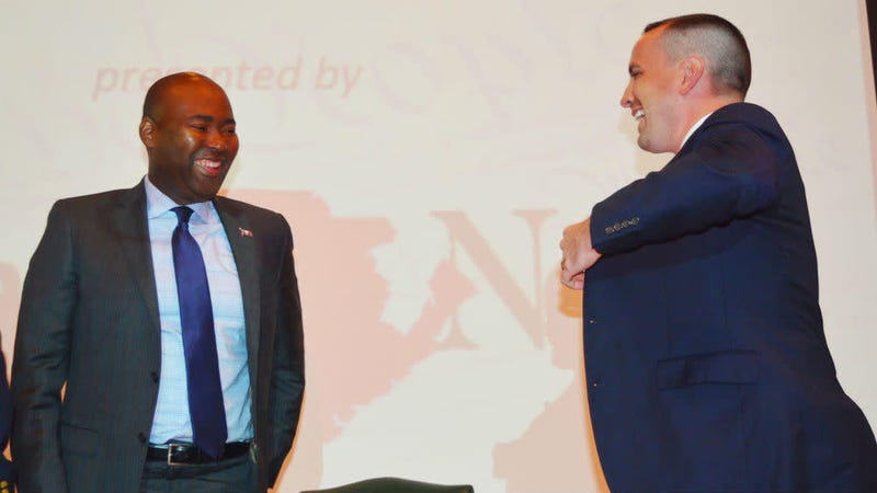 In this Sept. 8, 2016 photo, South Carolina Democratic Party Chairman Jaime Harrison and his GOP counterpart, Chairman Matt Moore, laugh after a recent voter education forum in Florence, S.C. Harrison has now announced his candidacy to unseat GOP Sen. Lindsey Graham of South Carolina in 2020.