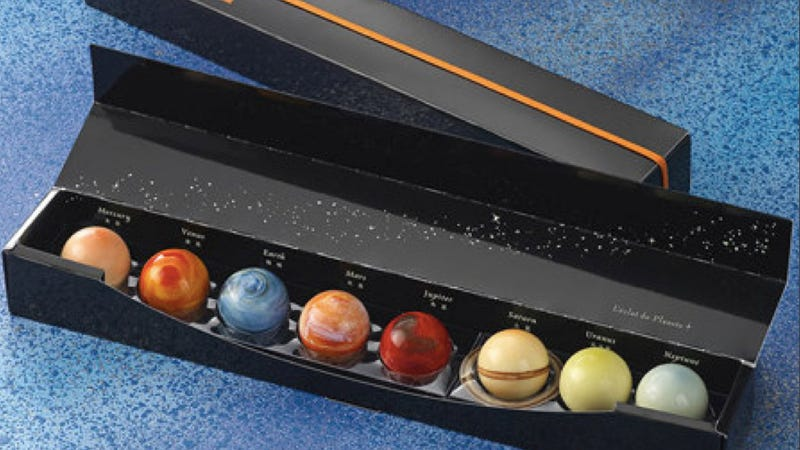 Illustration for article titled Now you can eat the solar system with these beautiful planet truffles