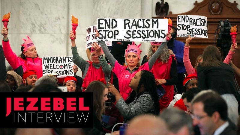 Image of Code Pink protesters at Russell Senate Office Building on January 10, 2017 before the start of Sessions hearing. Image via Getty.