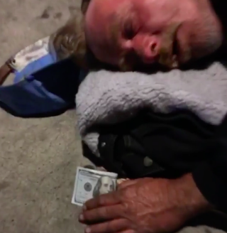 Man sleeping on street to whom the Game gave a $100 billInstagram