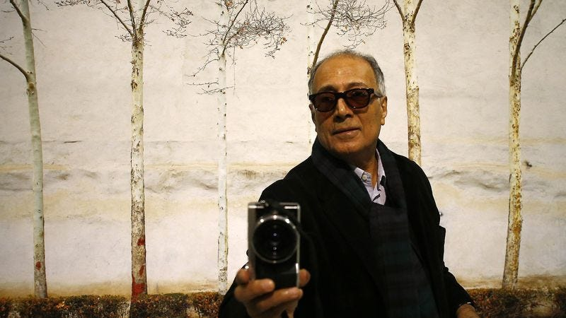 Abbas Kiarostami snaps a photo at a museum retrospective earlier this year. (Photo: Anadolu Agency / Getty Images)