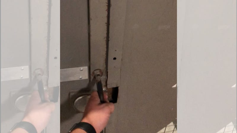 Illustration for article titled Who's the Brain Genius That Designed This Security Door? [Corrected]