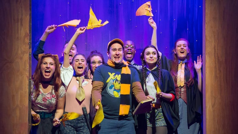 The cast of off-Broadway play, Puffs, showing their school spirit in yellow and black.