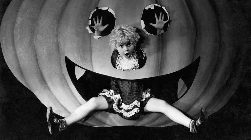 Halloween girl and her pumpkin