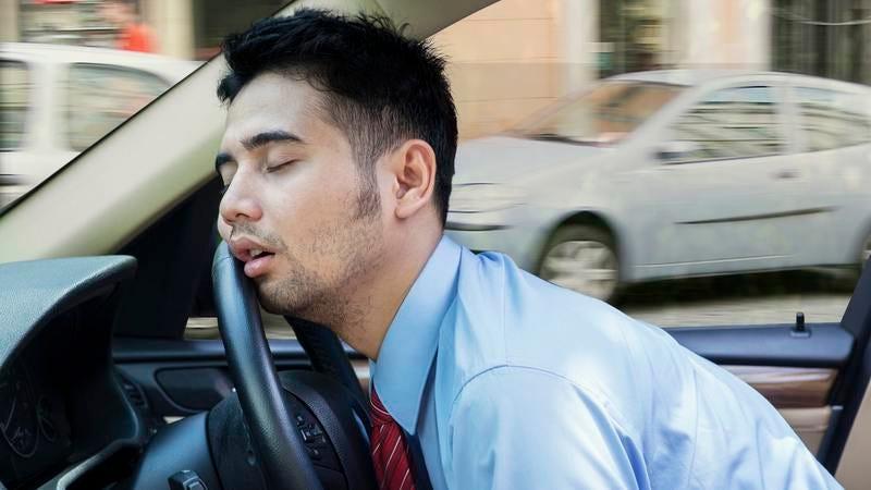 A man asleep at the wheel.