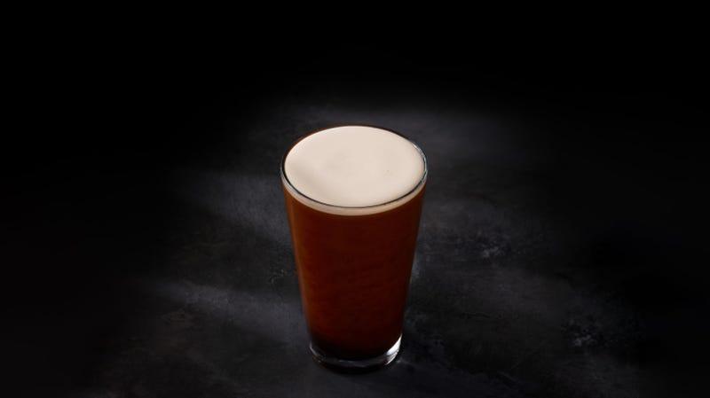 A foamy glass of nitro cold brew