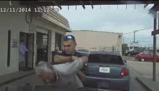 Officer Nathanial Robinson slamming Pete Vasquez into the police cruiser Dec. 11, 2014, as shown by dash-cam footageYouTube screenshot