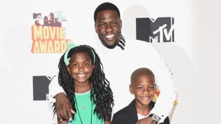 Kevin Hart, recipient of the Comedic Genius Award, poses with his children, Heaven and Hendrix, in the press room during the 2015 MTV Movie Awards at Nokia Theatre L.A. Live on April 12, 2015, in Los AngelesMichael Buckner/Getty Images