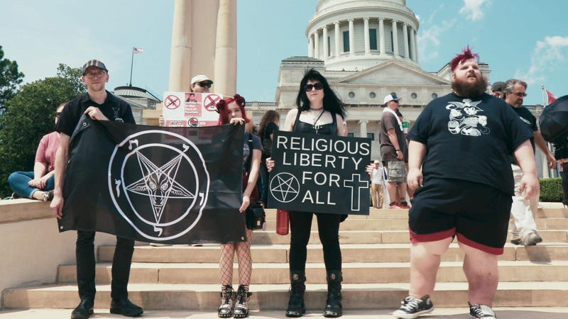Illustration for article titled Hail Satan? is an insider look at an activist movement born to raise hell