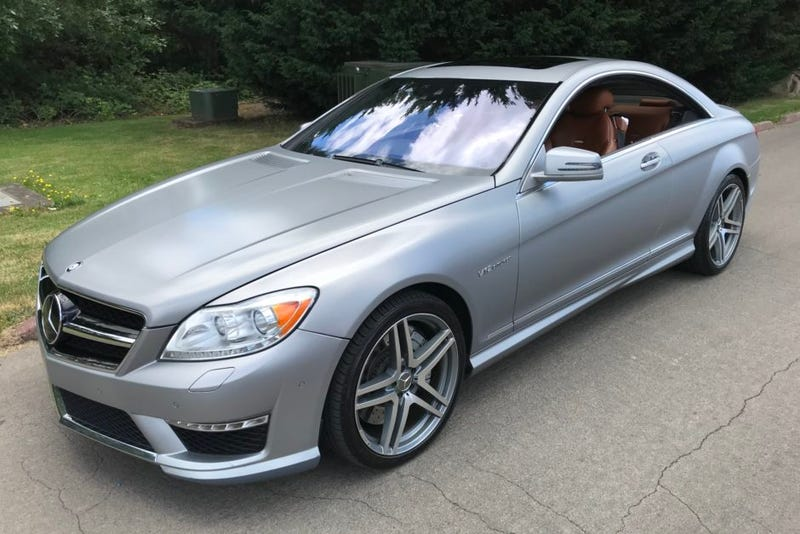 Illustration for article titled Get this pillarless 2011 CL63 AMG for a song!*