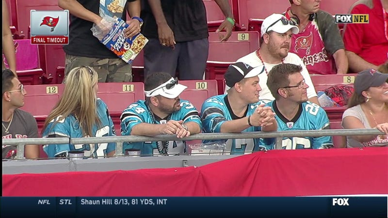 Illustration for article titled Dude Eats Cereal Out Of Box At Panthers-Bucs Game Like It's No Big Deal