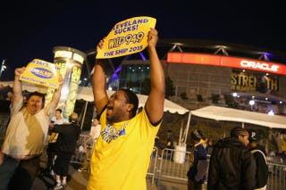 Golden State Warriors fans celebrate their team's 2015 NBA Finals win in front of Oracle Arena in Oakland, Calif., June 16, 2015. This is the first championship win for the Warriors since 1975.Justin Sullivan/Getty Images