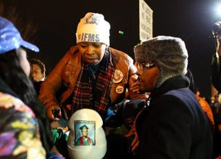 Lesley McSpadden, the mother of Michael Brown, is escorted away from in front of the Ferguson (Mo.) Police Department Nov. 24, 2014, after a grand jury's decision not to indict Ferguson Police Officer Darren Wilson in the shooting death of her son.Justin Sullivan/Getty Images