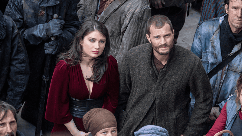 "Marian (Eve Hewson) and Will Scarlet (Jamie Dornan) ""fight"" for the people."