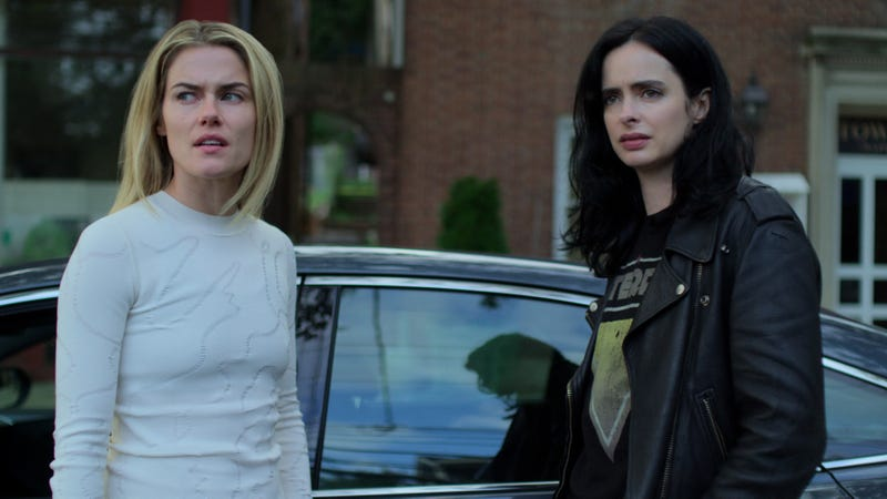 Rachael Taylor as Trish Walker and Krysten Ritter as Jessica Jones, expressing their disdain for something.