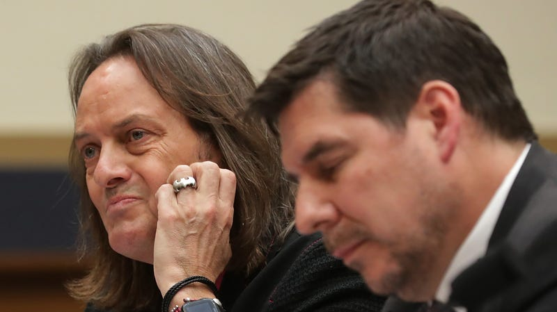 "T-Mobile CEO John Legere (L) and Sprint Executive Chairman Marcelo Claure testify before the House Judiciary Committee's Antitrust, Commercial and Administrative Law Subcommittee in the Rayburn House Office Building on Capitol Hill March 12, 2019 in Washington, DC. The corporate leaders and other experts testified about the ""state of competition in the wireless market"" and the possible impacts of the proposed merger of T-Mobile and Sprint would have on consumers in rural areas, workers and the future of 5G broadband internet access."