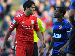Luis Suarez (left) and Patrice Evra (Andrew Yates/AFP/Getty Images)