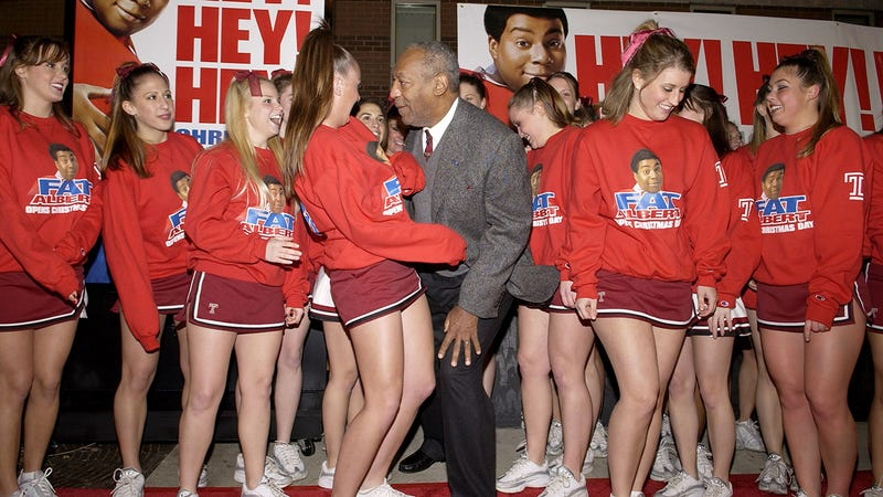 Bill Cosby with Temple cheerleaders at the premiere of Fat Albert in December 2004.