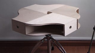Make an Awesome Coffee Table Out of Magazine Holders and a Stool
