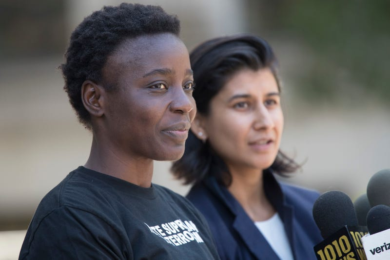 Patricia Okoumou and her attorney Rhiya Trivedi as she speaks to reporters outside Federal court, Thursday, July 5, 2018, in New York. Okoumou pleaded not guilty to misdemeanor trespassing and disorderly conduct for climbing the base of the Statue of Liberty on a busy Fourth of July to protest U.S. immigration policy.