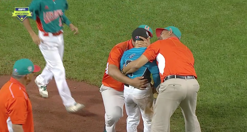 Illustration for article titled Opposing Coaches And Players Console Little League Pitcher After Walk-Off