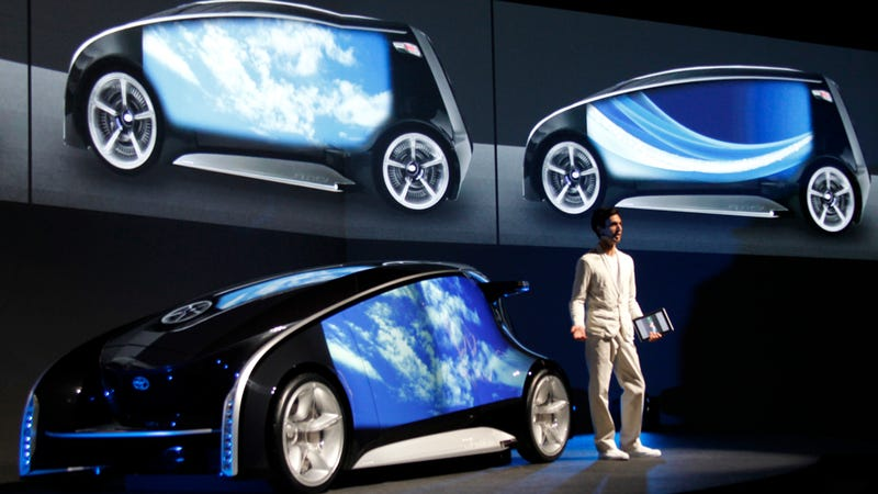 Illustration for article titled Toyota's Insane Concept Car Has Giant Touch-Screen Doors