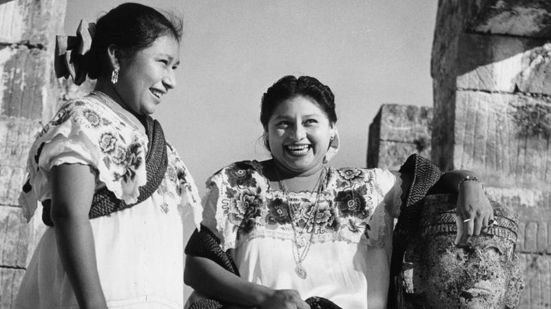 Two Mayan women visit the Temple of the Warriors circa 1950.