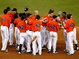 Miami Marlins celebrate victory Sunday on Jackie Robinson Day. (Mike Ehrmann/Getty Images)