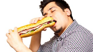 Illustration for article titled The Science Behind Why Men Eat More When Ladies Are Around