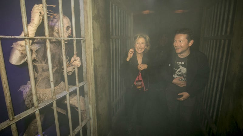 Saw and Insidious creator Leigh Whannell walks through the Insidious maze at Horror Nights with co-star Lin Shaye. Image: Universal