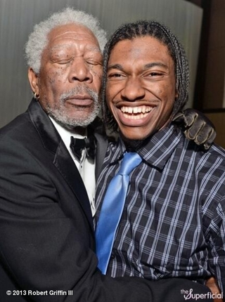 Illustration for article titled Please Enjoy This Photo Of Morgan Freeman Nuzzling Robert Griffin III