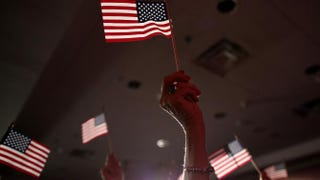 Supporters of Republican U.S. Rep. Tom Cotton, who won Arkansas' U.S. Senate race Nov. 4, 2014, hold American flags during an election-night gathering.Justin Sullivan/Getty Images