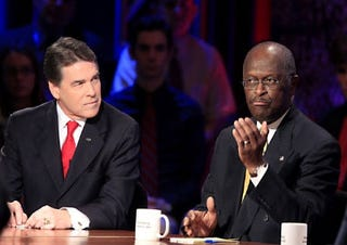 Rick Perry and Herman Cain (Getty)