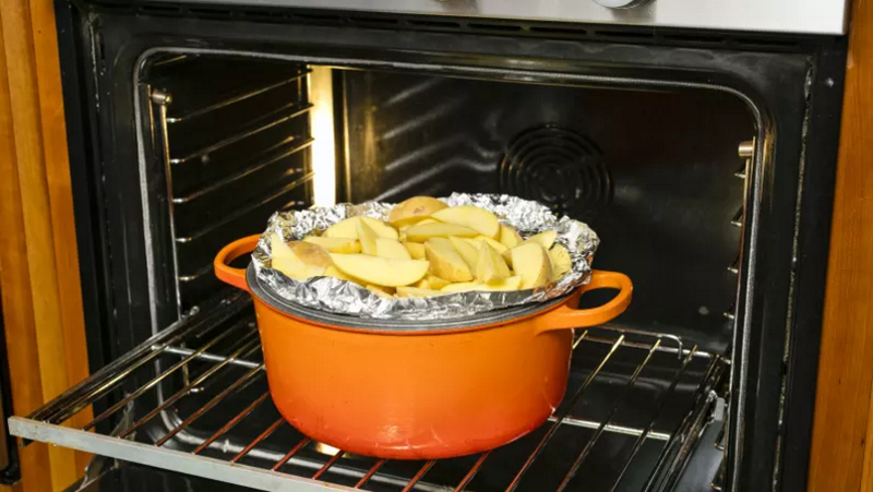 Illustration for article titled Make Your Dutch Oven Pull Double Duty by Flipping Over Its Lid and Using It as a Baking Sheet