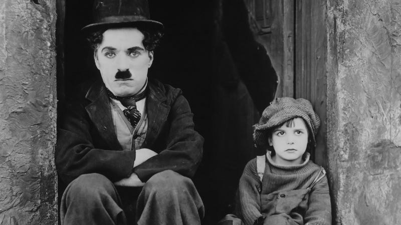 """Charlie Chaplin and his """"kid"""" are not amused."""