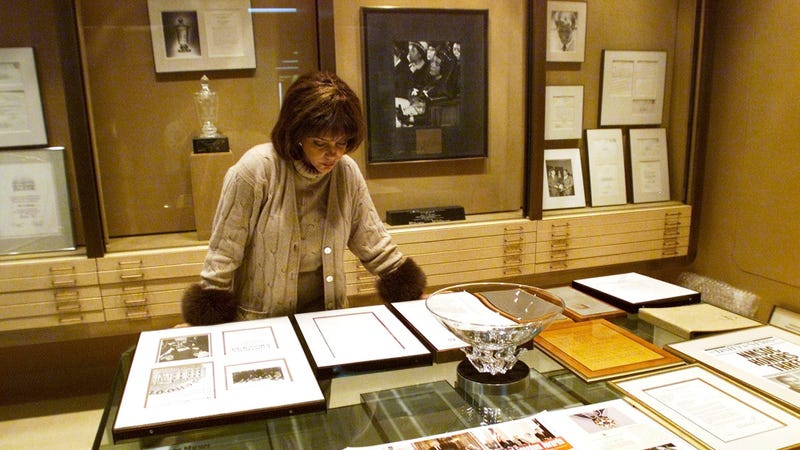 Linda Johnson Rice, president of Jet magazine, looking over awards won by the magazine in 2001.
