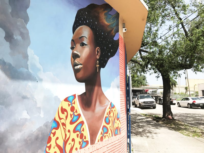 Murals like this one cover the walls of numerous buildings in predominantly black Miami neighborhoods like Liberty City and Little Haiti. (Ashley Velez/The Root)